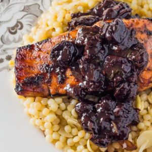 Romantic dinner Recipe for Chipotle Cherry Sauce over Broiled Salmon on a bed of Lemony Israeli Couscous, featuring Spiced Sour Cherry Spread by The Gracious Gourmet, available at spoonabilities.com