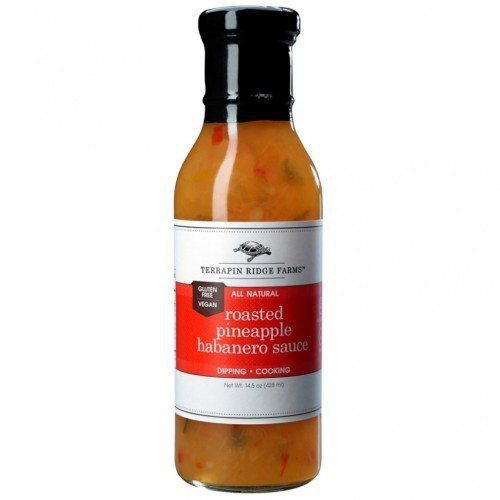 A bottle of Roasted Pineapple Habanero Sauce has a sweet caramelized roasted pineapple taste combined with veggies and fiery habaneros. Perfect for grilling & dipping. The sauce is Gluten Free, & Vegan. Available at Spoonabilities.com