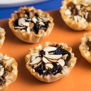 Fig Almond Tartlets Appetizer Recipe is one of our super easy & quick party bites recipes. This appetizer can be whipped up in under 30 minutes. This appetizer is perfect because it has the flavors of the holiday season with our Fig Almond Spread. Spoonabilities.com