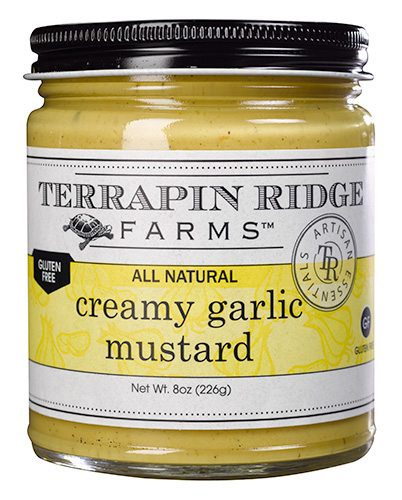 The Gourmet Mustard Gift Set includes the Creamy Garlic Mustard. This Amazing combination of garlic and creamy mustard will be the first to go at any party. Producer Terrapin Ridge Farms available at Spoonabilities.com