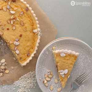 Traditional Swiss Easter Rice Tart Recipe: custard type filling with rice pudding, citrusy lemon, ground almond and crunchy sweet tart. Made in Switzerland only during Easter. Spoonabilities.com
