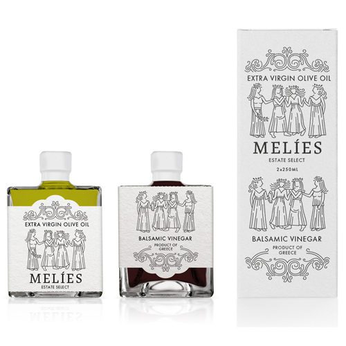 Melies Greek Olive Oil Vinegar Gift Set in carton box. High-quality EVOO and balsamic vinegar in two identical glass bottles that fit perfectly together.Available at Spoonabilities.com