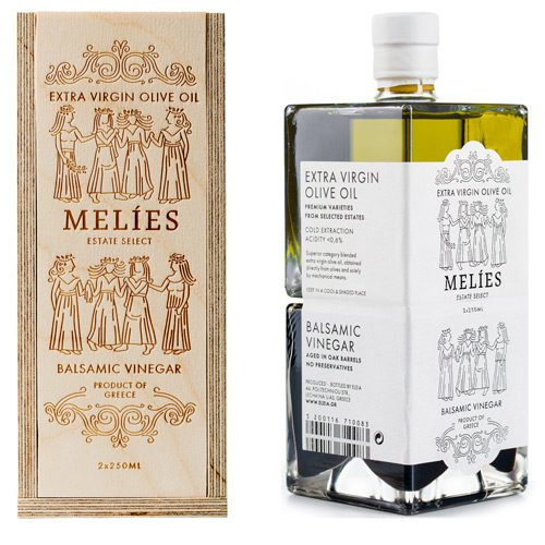 Melies Greek Olive Oil Vinegar Gift Set in a handcrafted wooden box. High-quality EVOO and balsamic vinegar in two identical glass bottles that fit perfectly together.. Paper box Available at Spoonabilities.com