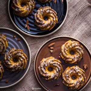 Mini Pumpkin Pecan Cakes are little bundt cakes perfect for breakfast and dessert. Made with chunks of toasted pecans and a citrus glaze. Spoonabilities.com