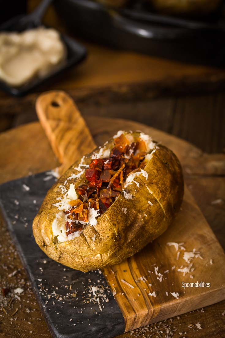 Spanish style double baked potato is perfectly baked with a crispy skin and fluffy interior. Spoonabilities.com