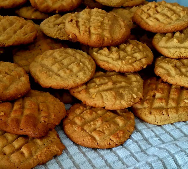 Best Peanut Butter Cookie Recipe stacked cooling cookies. Spoonabilities