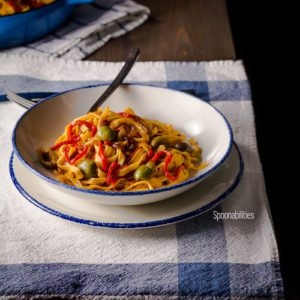 Roasted Red Pepper Pasta on a white plate with Sicilian Olives is a healthy, quick and easy pasta for any weeknight meal. Simple pasta recipe full of flavor. Spoonabilities.com